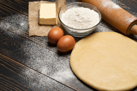 rolled and unbaked Shortcrust pastry dough recipe on wooden background Stock fotó
