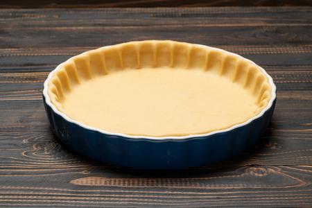 shortbread dough for baking quiche tart in baking form