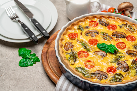 Baked homemade quiche pie in ceramic baking form Stock Photo