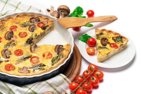 Baked homemade quiche pie in ceramic baking form Фото со стока