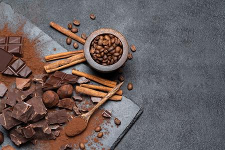 Dark or milk organic chocolate pieces and cocoa powder on dark concrete backgound Reklamní fotografie - 120362369