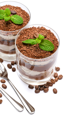 two portions Classic tiramisu dessert in a glass isolated on a white background
