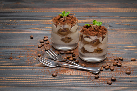 two portions Classic tiramisu dessert in a glass on wooden background Stock fotó