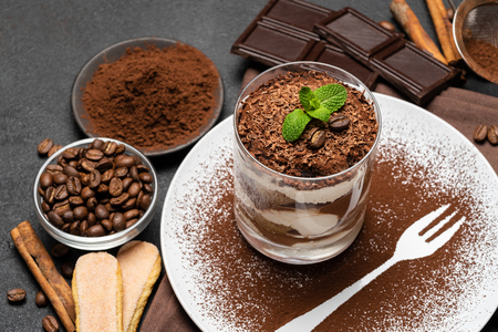 Classic tiramisu dessert in a glass on dark concrete background Stok Fotoğraf - 122596150