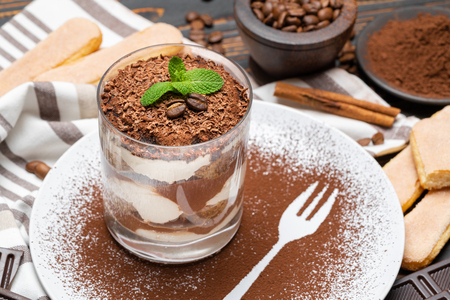 Classic tiramisu dessert in a glass on wooden background Stok Fotoğraf