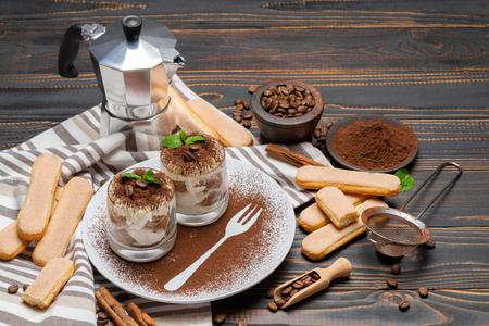Classic tiramisu dessert in a glass on wooden background 版權商用圖片