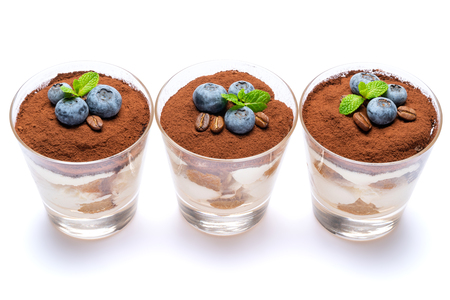 Classic tiramisu dessert with blueberries in a glass isolated on a white background with clipping path Stok Fotoğraf - 122597606