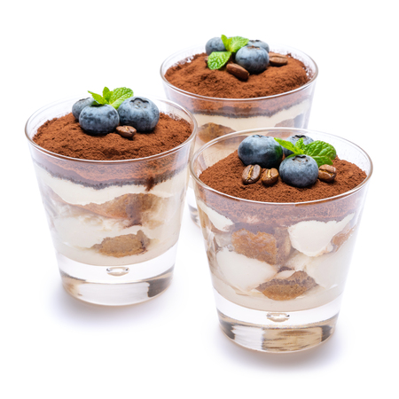 Classic tiramisu dessert with blueberries in a glass isolated on a white background with clipping path Stok Fotoğraf - 122597613