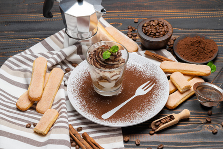 Classic tiramisu dessert in a glass on wooden background Stok Fotoğraf - 122747423
