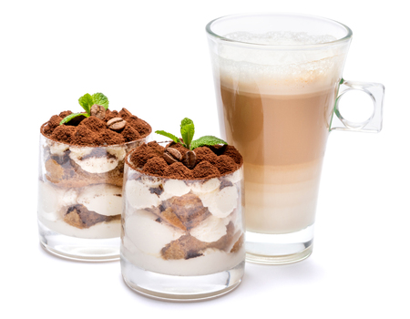 Classic tiramisu dessert in a glass and cup of coffee isolated on a white background with clipping path Stockfoto