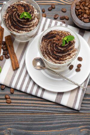 Classic tiramisu dessert in a glass on wooden background Reklamní fotografie