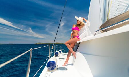 beautiful sexy woman in swimwear relaxing on a yacht Standard-Bild