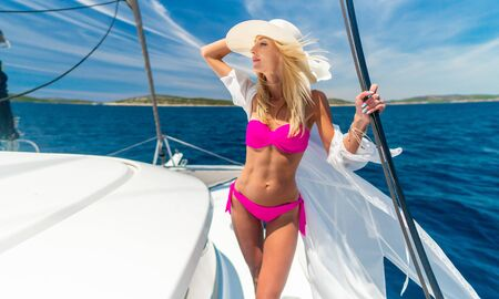 beautiful sexy woman in swimwear relaxing on a yacht Stock fotó