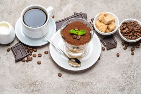 Classic tiramisu dessert in a glass, coffee, chocolate, cream and sugar on concrete background Reklamní fotografie - 128693847