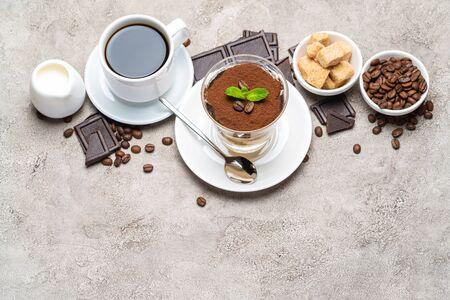 Classic tiramisu dessert in a glass, coffee, chocolate, cream and sugar on concrete background Reklamní fotografie