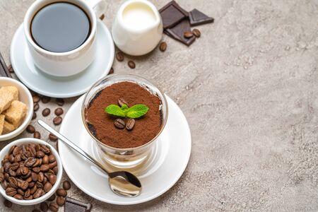 Classic tiramisu dessert in a glass, coffee, chocolate, cream and sugar on concrete background Reklamní fotografie - 128693866