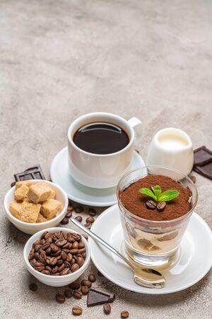 Classic tiramisu dessert in a glass, coffee, chocolate, cream and sugar on concrete background Reklamní fotografie - 128693875
