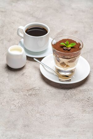 Classic tiramisu dessert in a glass, cup of espresso coffeeand cream on concrete background Reklamní fotografie - 128693878