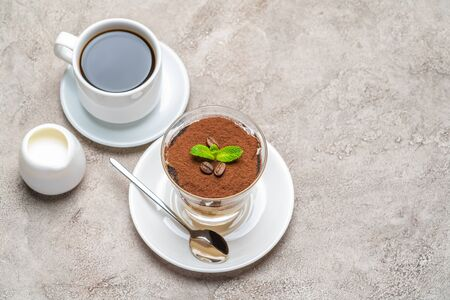 Classic tiramisu dessert in a glass, cup of espresso coffeeand cream on concrete background Reklamní fotografie - 128694045