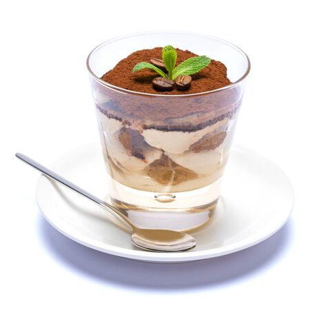 Classic tiramisu dessert in a glass cup on the plate on white background Reklamní fotografie - 128694047