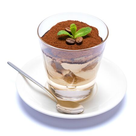 Classic tiramisu dessert in a glass cup on the plate on white background Reklamní fotografie - 128694062