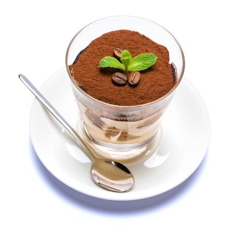 Classic tiramisu dessert in a glass cup on the plate on white background Reklamní fotografie - 128694059
