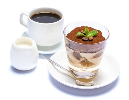 Classic tiramisu dessert in a glass, cup of espresso coffee and cream isolated on white background Reklamní fotografie - 128694065