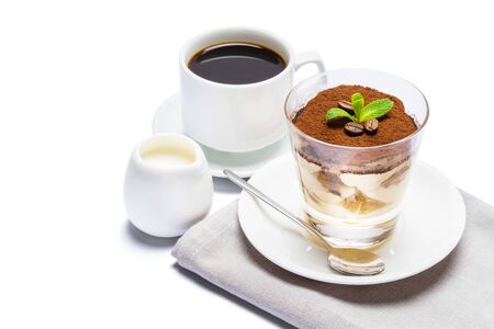 Classic tiramisu dessert in a glass, cup of espresso coffee and cream isolated on white background Reklamní fotografie - 128694075