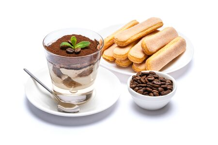 Classic tiramisu dessert in a glass cup, savoiardi cookies and coffee beans on white background Reklamní fotografie - 128694068