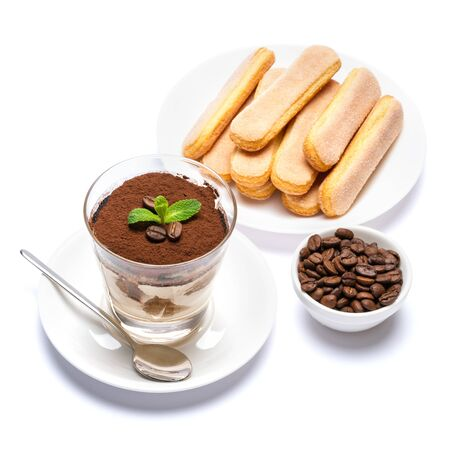 Classic tiramisu dessert in a glass cup, savoiardi cookies and coffee beans on white background Reklamní fotografie