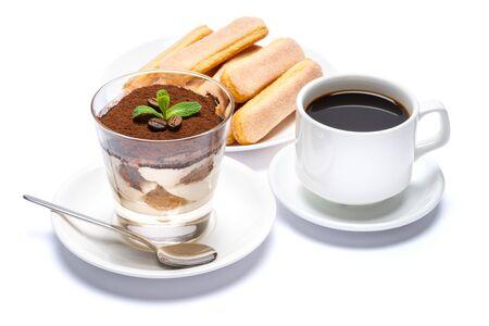Classic tiramisu dessert in a glass cup, savoiardi cookies and espresso coffee on white background Reklamní fotografie