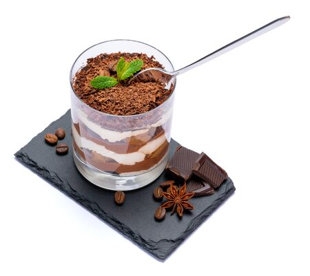 Classic tiramisu dessert in a glass cup and pieces of chocolate on stone cutting board on white background with clipping path Stock fotó