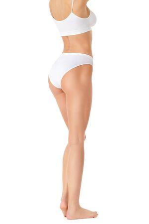 Slim long womans legs isolated on white background Reklamní fotografie