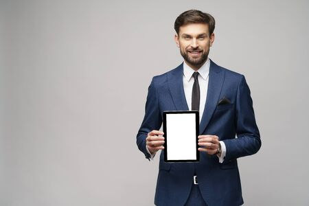 Young Businessman presenting digital tablet pc pad with blank screen