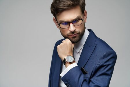 Studuo shot of thinking businessman wearing suit