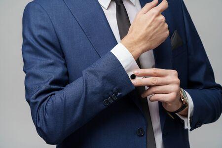 studio shot stylish businessman wearing suit and watches