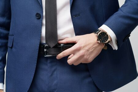close-up studio shot stylish businessman wearing suit and watches