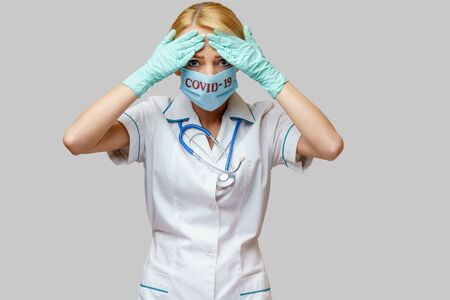 medical doctor nurse woman wearing protective mask and rubber or latex gloves - headache and stress Фото со стока