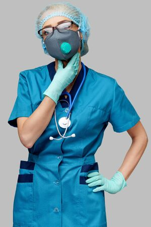 medical doctor nurse woman wearing protective mask and rubber or latex gloves - neck illness Фото со стока