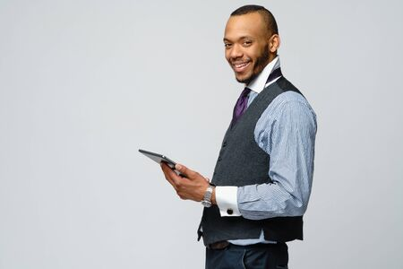 professional african-american business man holding tablet pc 版權商用圖片