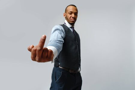 professional african-american business man - showing middle finger
