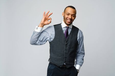 professional african-american business man - showing ok sign