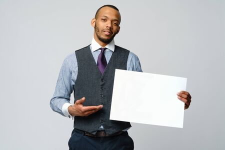 professional african-american business man - presenting holding blank sign
