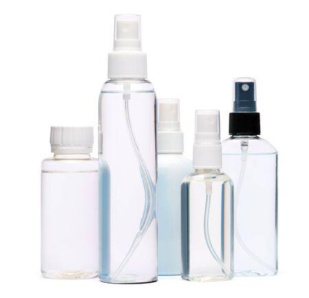 group of hand sanitizer spray bottles isolated on white background. Banco de Imagens