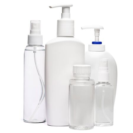 group of hand sanitizer spray and liquid soap bottles isolated on white background.