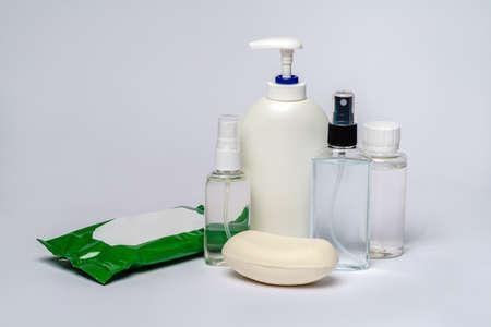 group of hand sanitizer spray or liquid soap bottles over light grey background. Foto de archivo