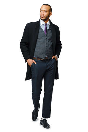 full length studio shot of a african-american businessman wearing coat Isolated on white background Zdjęcie Seryjne