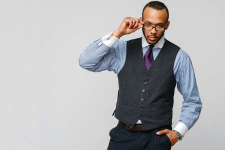 African-American businessmanman wearing glasses portrait over grey background