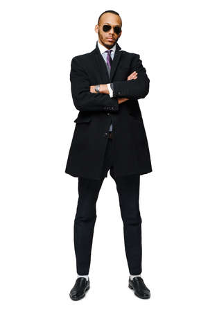 full length studio shot of a african-american businessman wearing coat Isolated on white background 写真素材