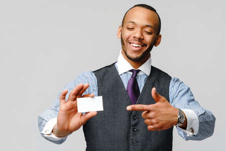 Afro-American businessman holding a white blank business card